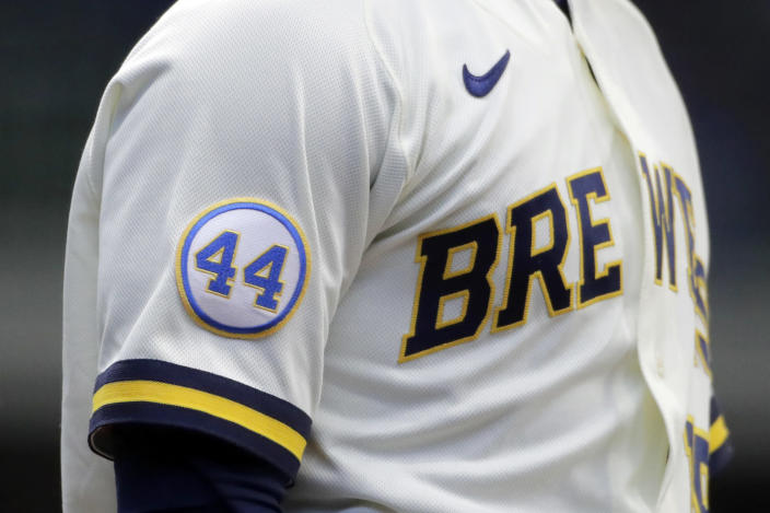 A patch to honor Hank Aaron is seen on the sleeve of Milwaukee Brewers' Keston Hiura during the first inning of an Opening Day baseball game against the Minnesota Twins Thursday, April 1, 2021, in Milwaukee. (AP Photo/Aaron Gash)