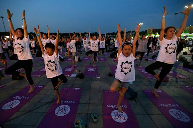 <p>Children perform yoga to mark the International Day of Yoga in Seoul, South Korea, Wednesday, June 21, 2017. (Photo: Ahn Young-joon/AP) </p>