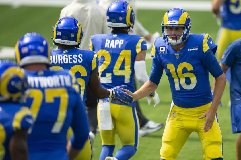 Los Angeles Rams quarterback Jared Goff (16) greets his teammates before an NFL football game.