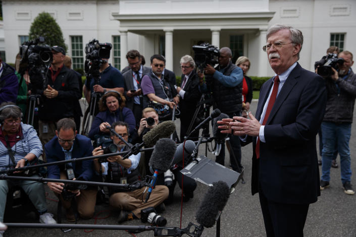National security adviser John Bolton talks to reporters outside the White House about Venezuela, Wednesday, May 1, 2019, in Washington. (AP Photo/Evan Vucci)