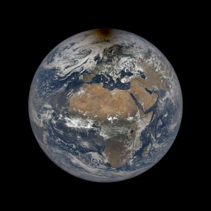 An image of the Earth with a dollop of shadow over its arctic generated by the Moon moving between our planet and the Sun.