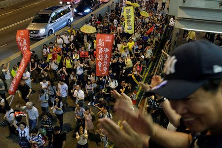 Demonstrators cheer up during a protest to demand authorities scrap a proposed extradition bill with China, in Hong Kong, China April 28, 2019. REUTERS/Tyrone Siu