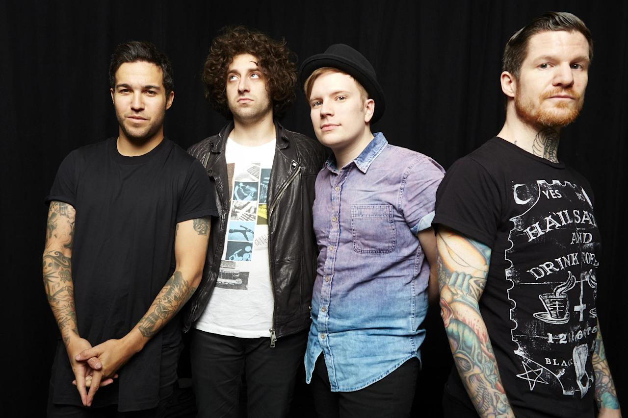 "This April 12, 2013 photo shows members of the band Fall Out Boy, from left,Pete Wentz, Joe Trohman, Patrick Sump and Andy Hurley in New York. Fall Out Boy's new album, ""Save Rock and Roll,"" released April 16, features Elton John on the title track. (Photo by Dan Hallman/Invision/AP)"