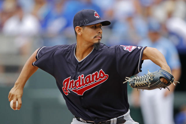 FILE - In this Sept. 30, 2018, file photo, Cleveland Indians pitcher Carlos Carrasco throws during the first inning of a baseball game against the Kansas City Royals, in Kansas City, Mo. The Indians have picked up their $9.75 million contract option on Carlos Carrasco for next season. (AP Photo/Charlie Riedel, File)