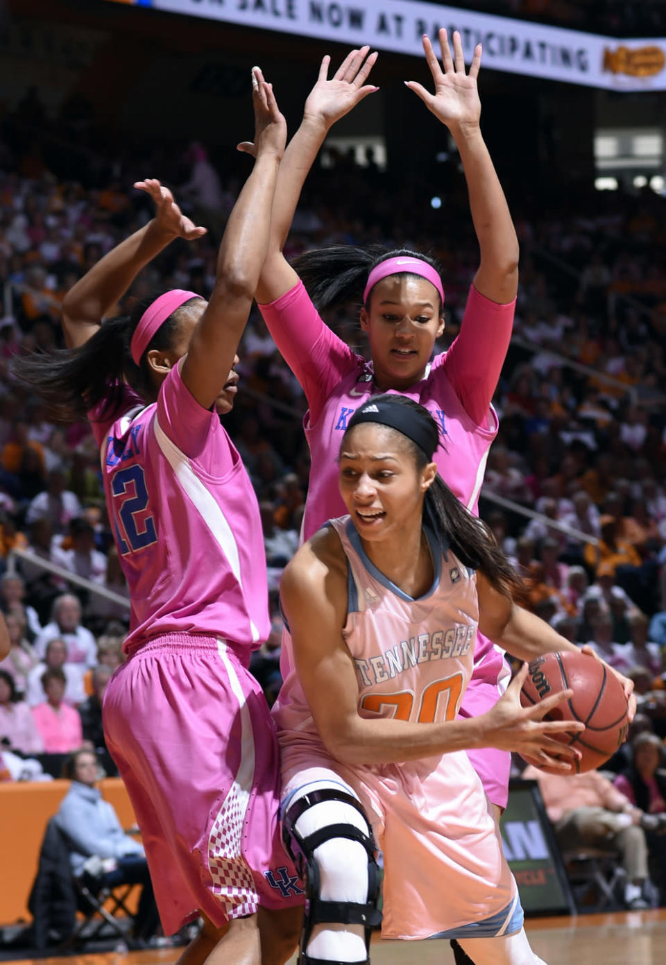 Tennessee's Isabelle Harrison (20) is double teamed by Kentucky defenders under the basket during the first half of an NCAA college basketball game, Sunday, Feb. 15, 2015, in Knoxville, Tenn. (AP Photo/Patrick Murphy-Racey)