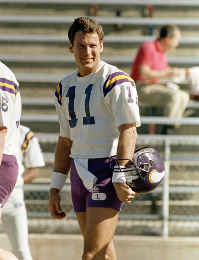 FILE - In this Jan. 8, 1988, file photo, Minnesota Vikings quarterback Wade Wilson is all smiles at the start of NFL football practice in Tucson, Ariz. The Cowboys say former NFL quarterback and longtime assistant coach Wade Wilson passed away Friday, Feb. 1, 2019, at his home in Coppell, Texas. The team didnt specify a cause of death for Wilson, who died on his 60th birthday. Wilson played for five NFL teams from 1981-98, including 10 seasons for the Vikings, leading them to the 1987 NFC Championship Game. (AP Photo/Jeff Robbins, File)