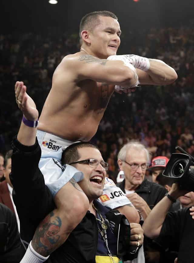 Marcos Maidana, from Argentina, celebrates at the end of his WBC-WBA welterweight title boxing fight against Floyd Mayweather Jr., Saturday, May 3, 2014, in Las Vegas. Mayweather won the bout by majority decision. (AP Photo/Isaac Brekken)
