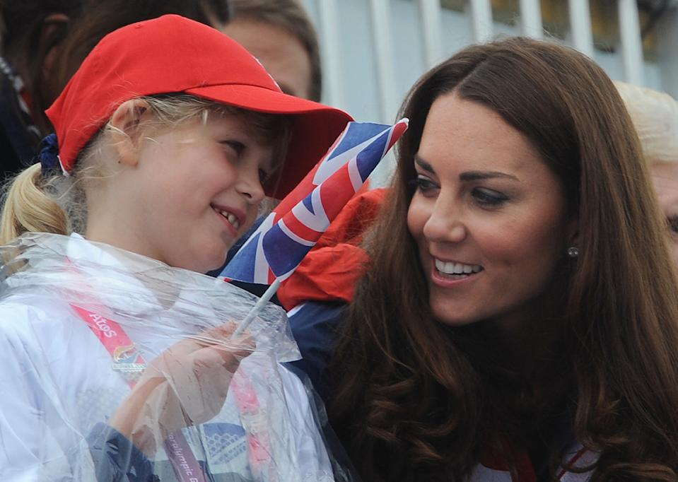 Britain's Catherine, Duchess of Cambridge (R) and Lady Louise Windsor watch the rowing finals during the London 2012 Paralympic Games at Eton Dorney, west of London, on September 2, 2012.  AFP PHOTO / STEFAN ROUSSEAU/POOL        (Photo credit should read STEFAN ROUSSEAU/AFP/GettyImages)