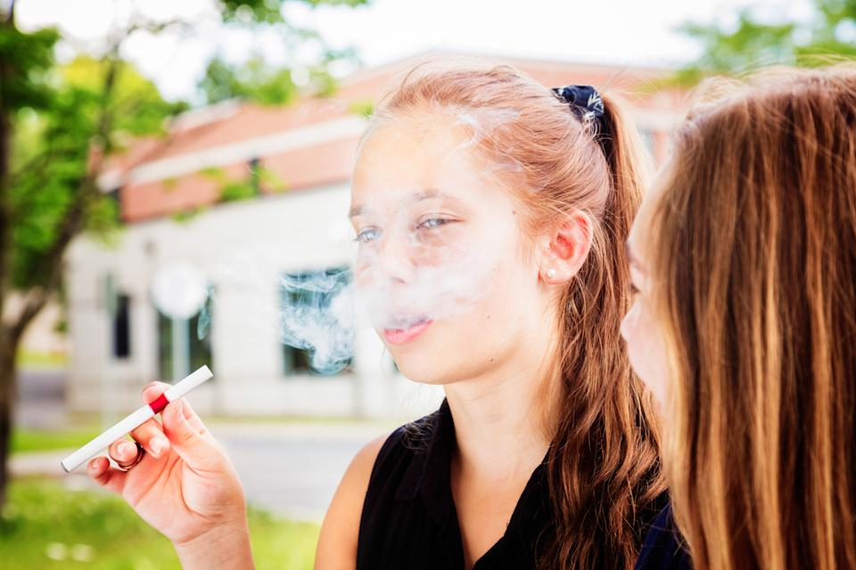 A new study from Stanford University suggests that teens and young adults who vape are five times more likely to get diagnosed with COVID-19 than those who don't. (Photo: Getty Images)