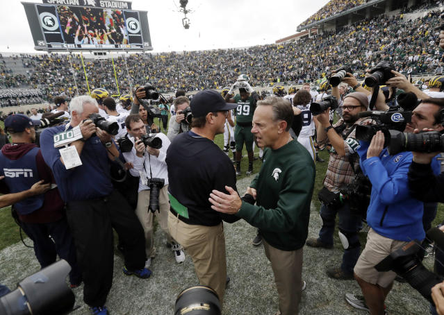 Michigan is heading to the Outback Bowl while Michigan State — with a better record — is going to the Holiday Bowl. (AP Photo/Carlos Osorio, File)