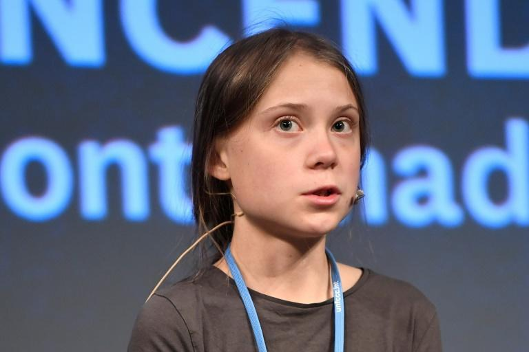 Teen eco-warrior Thunberg -- who refuses to fly because of the carbon emissions involved -- spoke to reporters before joining a rally after a nearly three-week journey across the Atlantic by catamaran