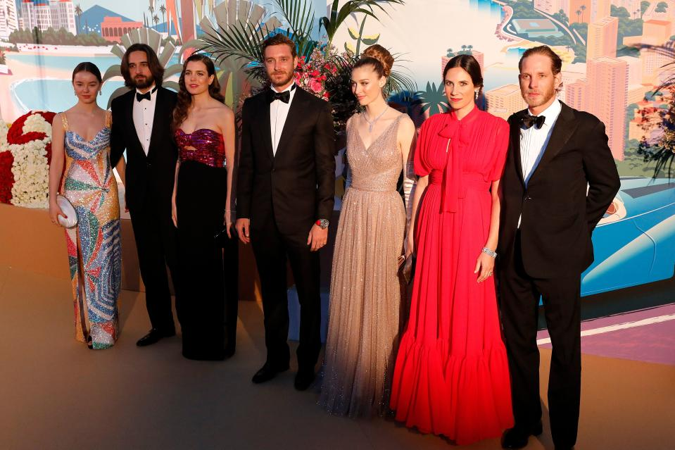(FromL) Princess Alexandra of Hanover, Dimitri Rassam, Charlotte Casiraghi, Pierre Casiraghi, Beatrice Boromeo, Tatiana Santo Domingo and Andrea Casiraghi pose as they arrive for the 'Bal de la Rose' (Rose Ball), in Monaco, on March 30, 2019. - The Rose Ball is a traditional annual charity event in the Principality of Monaco. This year the theme is 'Riviera', designed by late German Karl Lagerfeld and Princess Caroline of Hanover. (Photo by Sebastien NOGIER / POOL / AFP)        (Photo credit should read SEBASTIEN NOGIER/AFP via Getty Images)