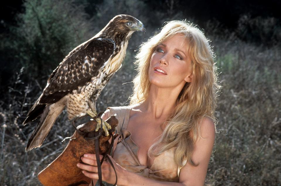 Tanya Roberts holding a perch with a bird on it in a scene from the film 'Sheena: Queen of the Jungle', 1984. (Photo by Columbia Pictures/Getty Images)