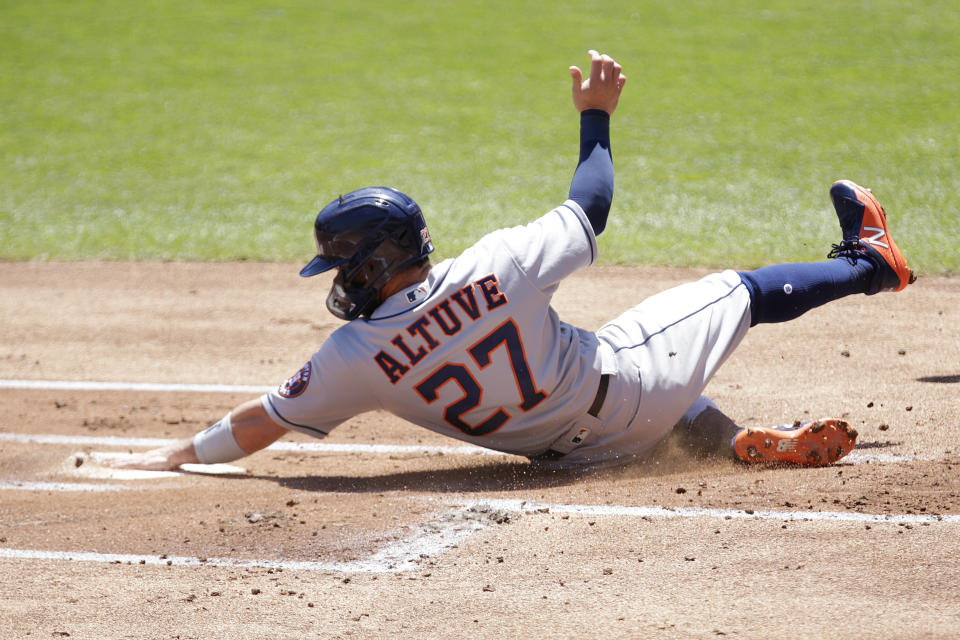 Houston Astros' Jose Altuve scores on a sacrifice fly against the Minnesota Twins in the first inning of a baseball game, Sunday, June 13, 2021, in Minneapolis. (AP Photo/Andy Clayton-King)