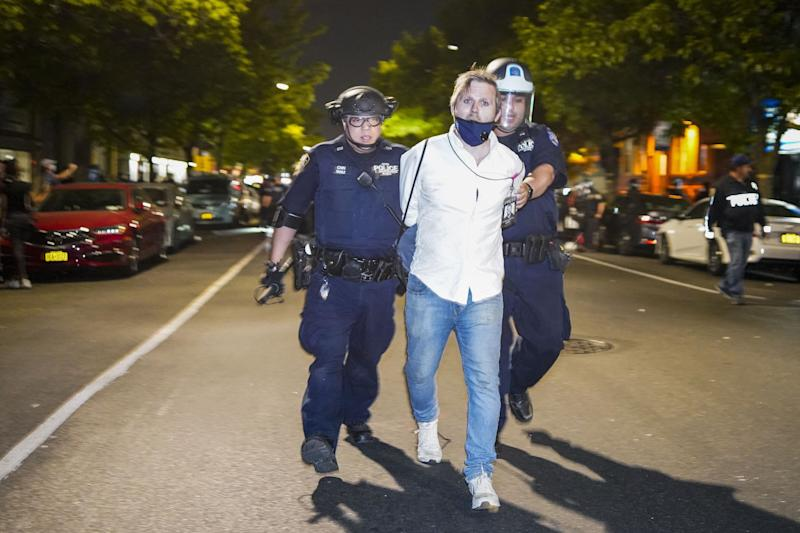 HuffPost senior reporter Chris Mathias was taken into custody while covering an anti-racism protest in New York on Saturday. (Photo: Corey Sipkin/UPI/Newscom)