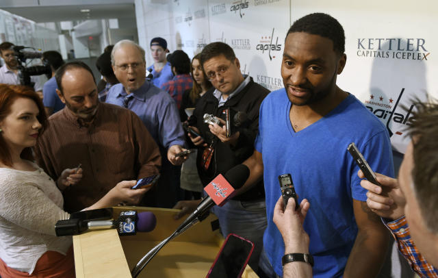 Washington Capitals right wing Joel Ward speaks to reporters at the Kettler Capitals Iceplex in Arlington, Va. Friday, May 15, 2015. The Capitals hockey team was eliminated from the Stanley Cup Playoffs and spent the day cleaning out their lockers in preparation for the off season. (AP Photo/Susan Walsh)
