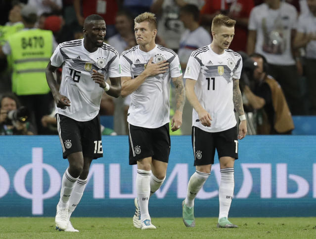 Germany's Toni Kroos celebrates after scoring his side's second goal with his teammate Germany's Antonio Ruediger, left, and Marco Reus, right, during the group F match between Germany and Sweden at the 2018 soccer World Cup in the Fisht Stadium in Sochi, Russia, Saturday, June 23, 2018. (AP Photo/Michael Probst)