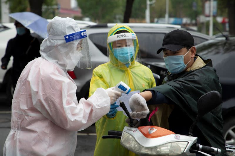 China reports 11 new mainland COVID-19 cases versus three a day earlier