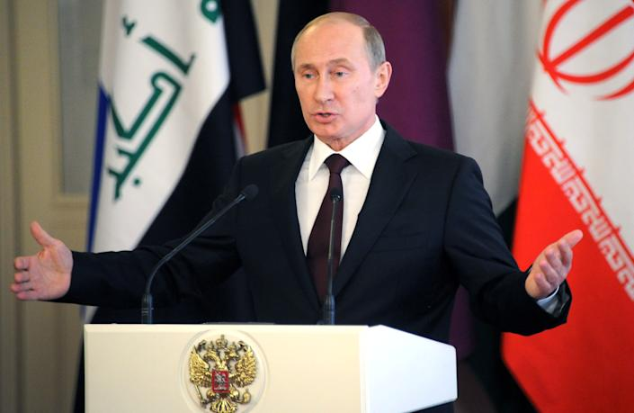 Russia's President Vladimir Putin speaks during his press conference at the Kremlin in  Moscow, on July 1, 2013. Putin said today that his country had never extradited anyone before and added that US leaker Edward Snowden could remain in Moscow if he stopped issuing his leaks. (Alexander Nemenov/AFP via Getty Images)