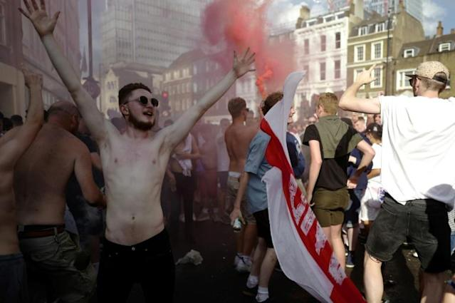 People celebrate in London after England beat Sweden in the World Cup quarter-finals