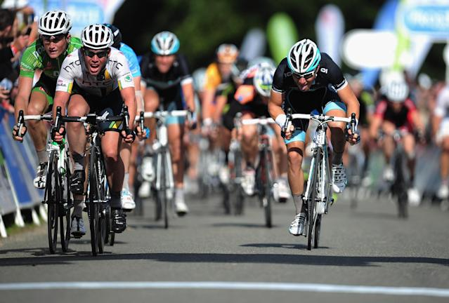 KING'S LYNN, ENGLAND - SEPTEMBER 17: Mark Cavendish of team HTC Highroad leads the Sprit Pelaton during the Tour of Britain Stage Seven at Sandringham on September 17, 2011 in King's Lynn, England. (Photo by Jamie McDonald/Getty Images)