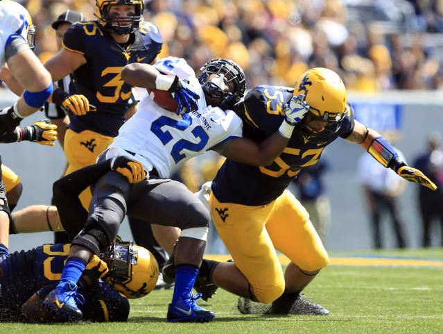 Georgia State's Jonathan Jean-Bart (22) is tackled by West Virginia's Dontrill Hyman (99) and Tyler Anderson (53) during the second quarter of an NCAA college football game in Morgantown, W.Va., on Saturday, Sept. 14, 2013. (AP Photo/Christopher Jackson)