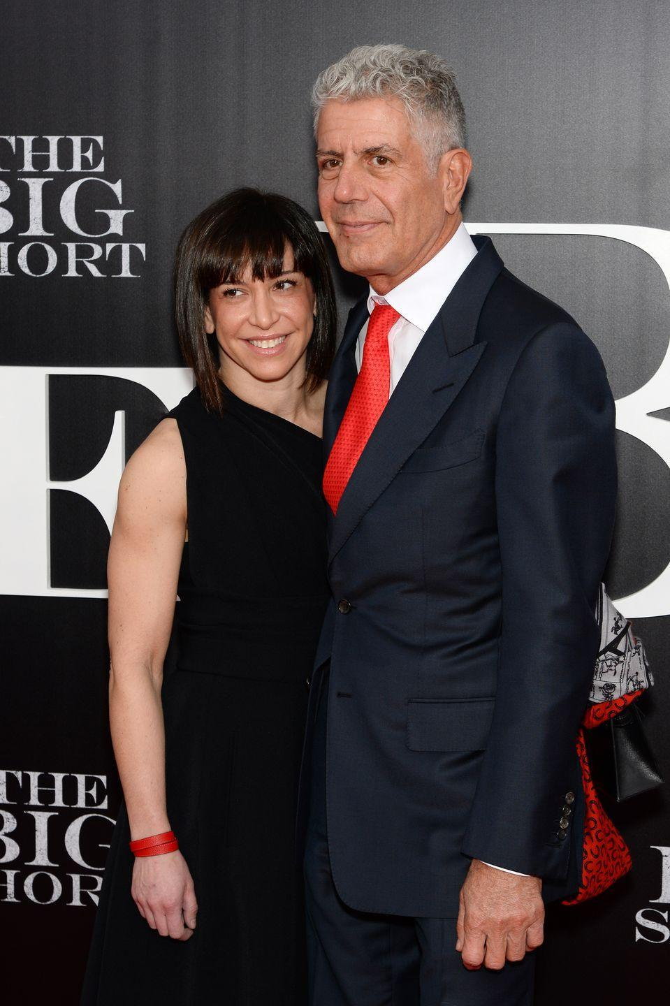 """<p>Bourdain's second wife, Ottavia, was a hostess at one of Ripert's restaurants when her whirlwind romance with Bourdain began. On their second date, the pair got matching tattoos of a chef's knife, and after their daughter Ariane born in 2007, they tied the knot within 11 days. The pair split in 2016, but remain on good terms, despite the <a href=""""http://www.esquire.com/lifestyle/news/a53303/anthony-bourdain-new-girlfriend-asia-argento/"""" rel=""""nofollow noopener"""" target=""""_blank"""" data-ylk=""""slk:new woman"""" class=""""link rapid-noclick-resp"""">new woman</a> in Bourdain's life.</p>"""