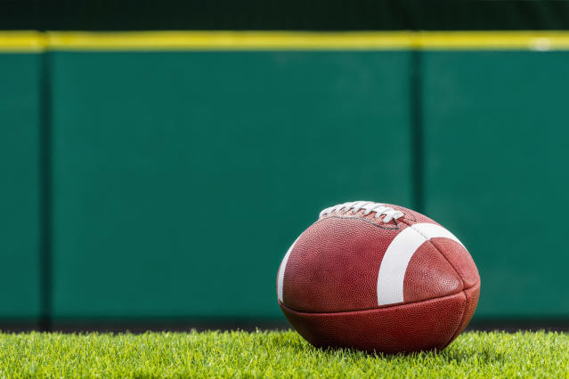 A high school football team is forfeiting an undefeated season after using an ineligible player. (Getty Images)