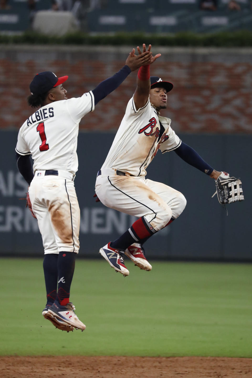 Atlanta Braves second baseman Ozzie Albies (1), left, and Ronald Acuna Jr., celebrate after defeating the Chicago White Sox 5-3 in a baseball game Sunday, Sept. 1, 2019, in Atlanta. (AP Photo/John Bazemore)
