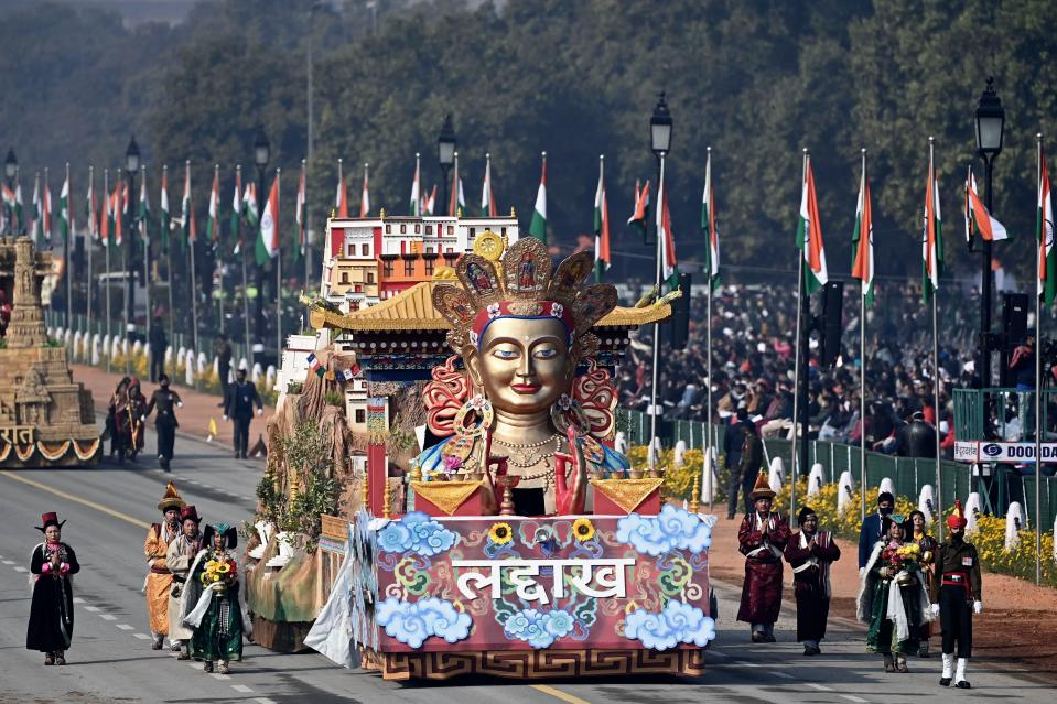 Performers dance next to a float representing Ladakh region on Rajpath during the Republic Day Parade in New Delhi on January 26, 2021. (Photo by Jewel SAMAD / AFP) (Photo by JEWEL SAMAD/AFP via Getty Images)