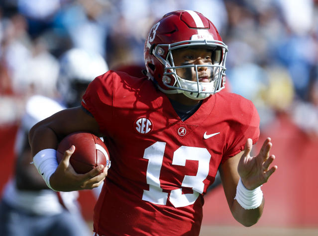 Alabama quarterback Tua Tagovailoa (13) carries the ball during the first half of an NCAA college football game against Citadel, Saturday, Nov. 17, 2018, in Tuscaloosa, Ala. (AP Photo/Butch Dill)