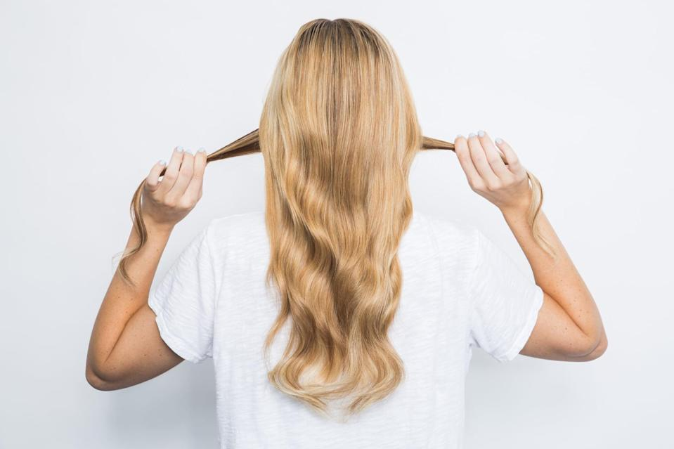<p>Sometimes you want to put your hair up for a quick moment to keep it out of your face or off your neck. The only problem is a hair elastic can leave that awkward bend in your blowout. Avoid that crease altogether by using your own strands as a hair tie.</p>