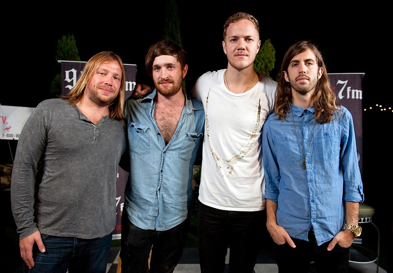 (L-R) Ben McKee, Daniel Platzman, Dan Reynolds and D. Wayne Sermon of the band Imagine Dragons pose after performing onstage at the 98.7FM Penthouse Party at The Historic Hollywood Tower on September 3, 2012 in Hollywood, California.  (Photo by Amanda Edwards/WireImage)