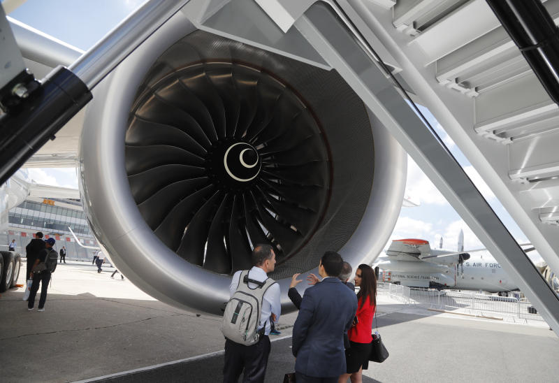 Visitor watch a jet engin propulsion of an Airbus 350-1000 at Paris Air Show, in Le Bourget, east of Paris, France, Monday, June 17, 2019. The world's aviation elite are gathering at the Paris Air Show with safety concerns on many minds after two crashes of the popular Boeing 737 Max. (AP Photo/Michel Euler)
