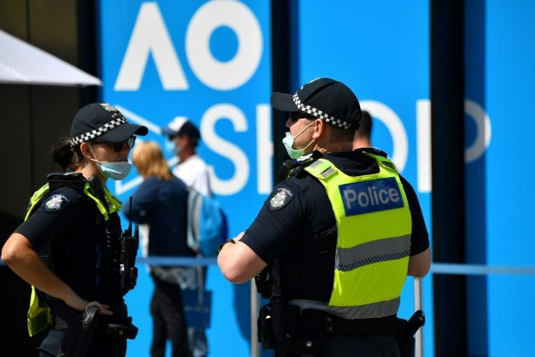 Police wear face masks on day five of the Australian Open tennis tournament in Melbourne on February 12, 2021