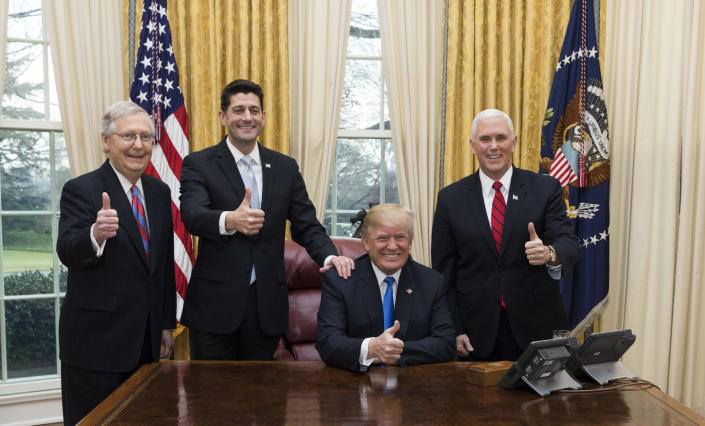 President Trump celebrates the passage of the Tax Cuts Act with Senate Majority Leader Mitch McConnell, Speaker of the House Paul Ryan, and Vice President Mike Pence. (Photo: Joyce N. Boghosian)