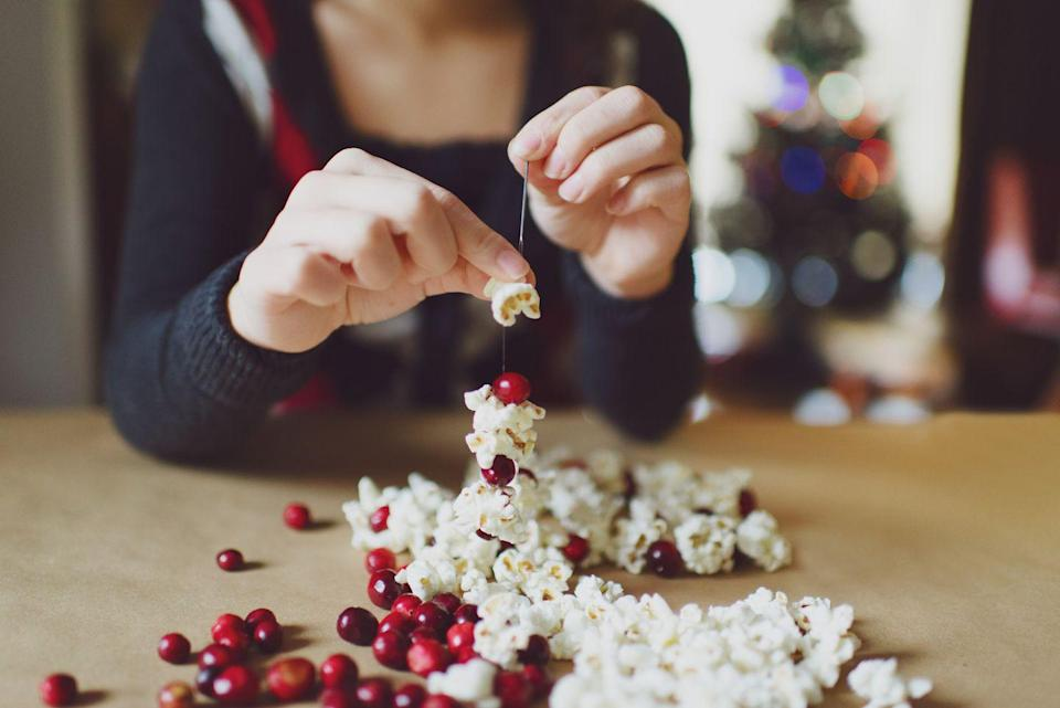 <p>Not only does a Christmas craft activity keep the kids busy while you cook or clean, it also doubles as decor. This popcorn-cranberry garland makes a pretty last-minute addition to your tree. Just pop up a batch, grab a bag of berries, some string and a sewing needle and you're ready to go. </p>