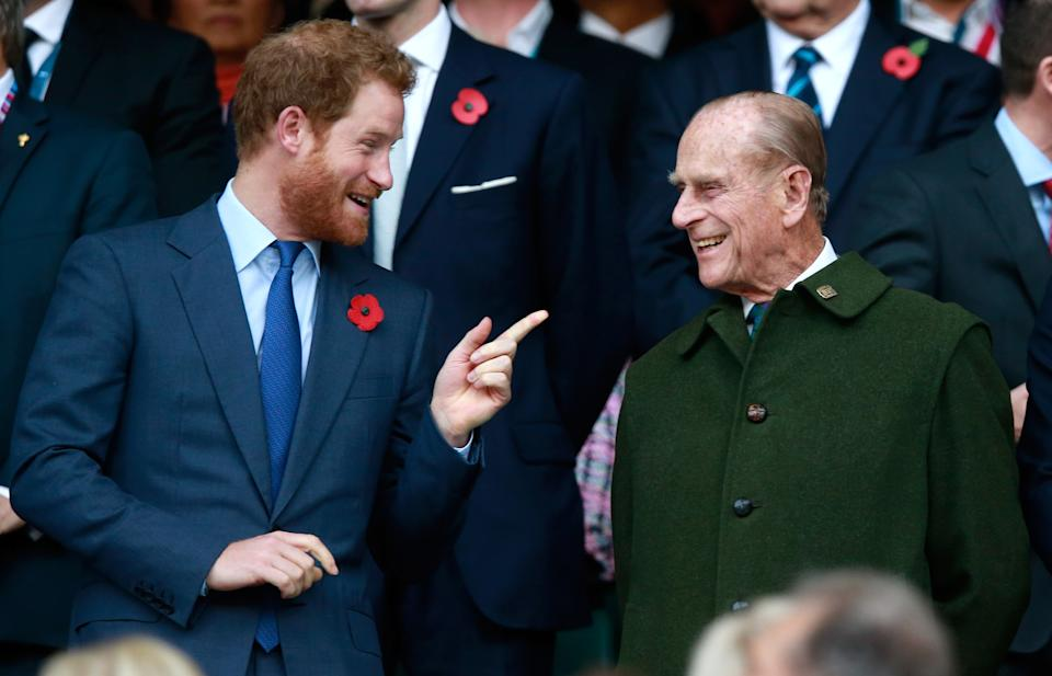 Prince Harry, Prince Phillip and Prince William enjoy the atmosphere during the 2015 Rugby World Cup Final match between New Zealand and Australia at Twickenham Stadium on October 31, 2015 in London, United Kingdom.