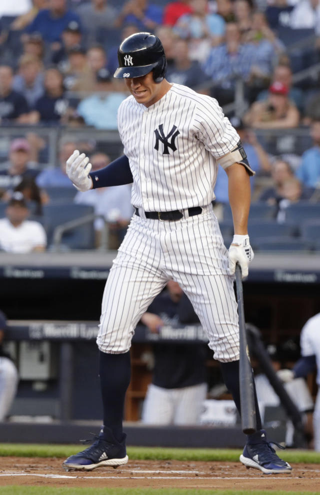 New York Yankees' Aaron Judge reacts after being hit by a pitch during the first inning of the team's baseball game against the Kansas City Royals on Thursday, July 26, 2018, in New York. The Yankees 2on 7-2. (AP Photo/Frank Franklin II)