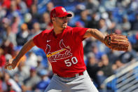 St. Louis Cardinals pitcher Adam Wainwright throws during the first inning of a spring training baseball game against the New York Mets Friday, Feb. 28, 2020, in Port St. Lucie, Fla. (AP Photo/Jeff Roberson)