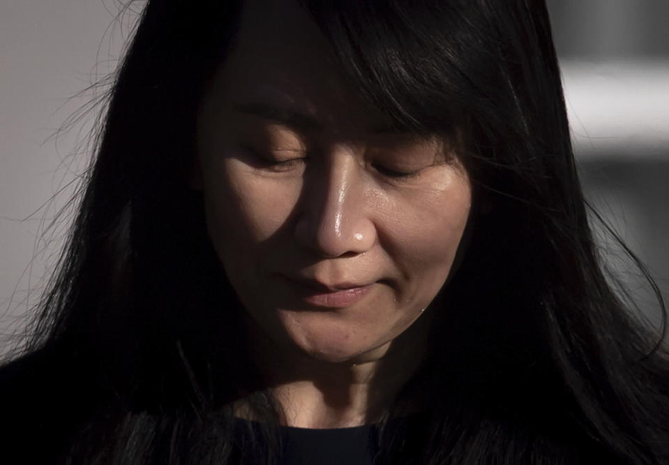 Meng Wanzhou, chief financial officer of Huawei, leaves her home to attend a hearing at B.C. Supreme Court, in Vancouver, British Columbia, on Monday, March 15, 2021. (Darryl Dyck/The Canadian Press via AP)