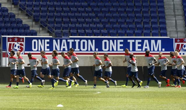 Members of the U.S. men's national soccer team run together during a team training session in Harrison