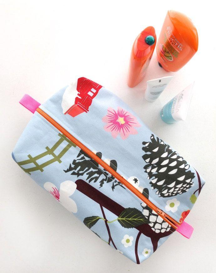 """<p>Help Mom travel in style on her next vacation so she can finally ditch her Ziploc bags to carry all of her essentials.</p><p><em><strong>Get the tutorial from <a href=""""https://mypoppet.com.au/makes/zippered-wash-bag-pattern-make-a-gift-from-one-mother-to-another/"""" rel=""""nofollow noopener"""" target=""""_blank"""" data-ylk=""""slk:My Poppet Makers"""" class=""""link rapid-noclick-resp"""">My Poppet Makers</a>.</strong></em></p><p><strong><a class=""""link rapid-noclick-resp"""" href=""""https://www.amazon.com/Embellish-Ribbons-Perfect-Wrapping-Decoration/dp/B08722TFPH/ref=sr_1_2?dchild=1&keywords=RIBBON&qid=1605822468&sr=8-2&tag=syn-yahoo-20&ascsubtag=%5Bartid%7C10063.g.34832092%5Bsrc%7Cyahoo-us"""" rel=""""nofollow noopener"""" target=""""_blank"""" data-ylk=""""slk:SHOP RIBBON"""">SHOP RIBBON</a></strong></p>"""