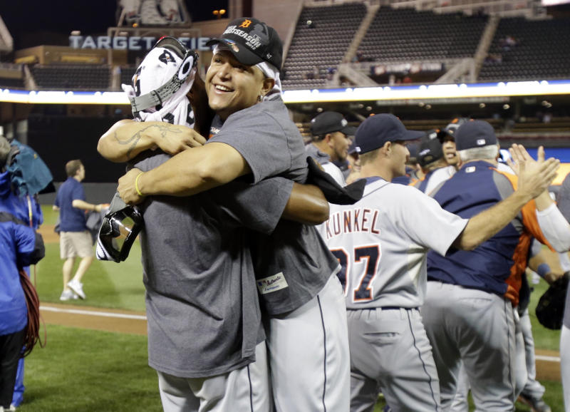 Detroit Tigers' Miguel Cabrera, right, gets a hug on the field after the Tigers won the American League Central Division title after beating the Minnesota Twins 1-0 in a baseball game, Wednesday, Sept. 25, 2013, in Minneapolis. (AP Photo/Jim Mone)