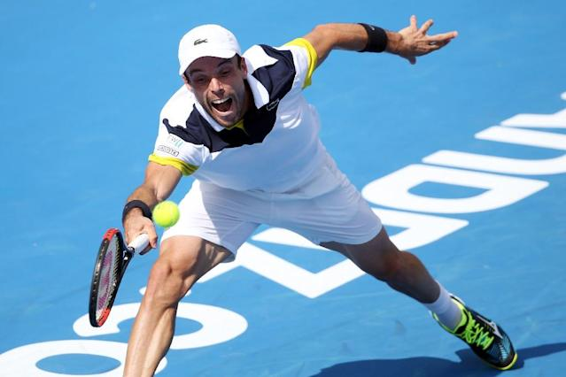 Roberto Bautista Agut of Spain hits a return against Juan Martin Del Potro of Argentina during their men's singles final at the ATP Auckland Classic (AFP Photo/MICHAEL BRADLEY)
