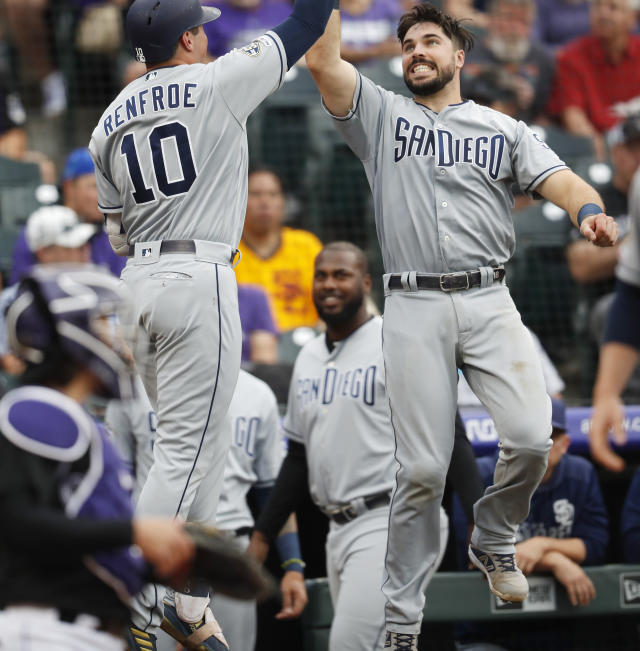 San Diego Padres' Hunter Renfroe, left, celebrates his solo home run with Austin Hedges as Renfroe returns to the dugout during the second inning of the team's baseball game against the Colorado Rockies on Friday, June 14, 2019, in Denver. (AP Photo/David Zalubowski)