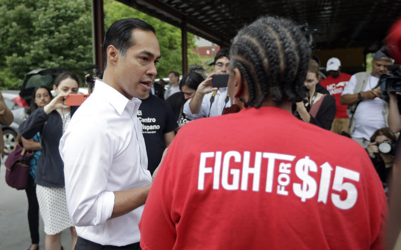 "In this May 23, 2019, photo, Democratic presidential candidate and former U.S. Department of Housing and Urban Development Julian Castro speaks with a supporter before rallying with McDonald's employees and other activists in Durham, N.C. Hispanics are poised to help shape the 2020 Democratic primary in unprecedented ways. They comprise almost 30% of the population in the state that votes third in presidential primaries, Nevada. And the nation's two largest Latino states, California and Texas, are among the 14 ""Super Tuesday"" states voting 10 just days later. (AP Photo/Gerry Broome)"
