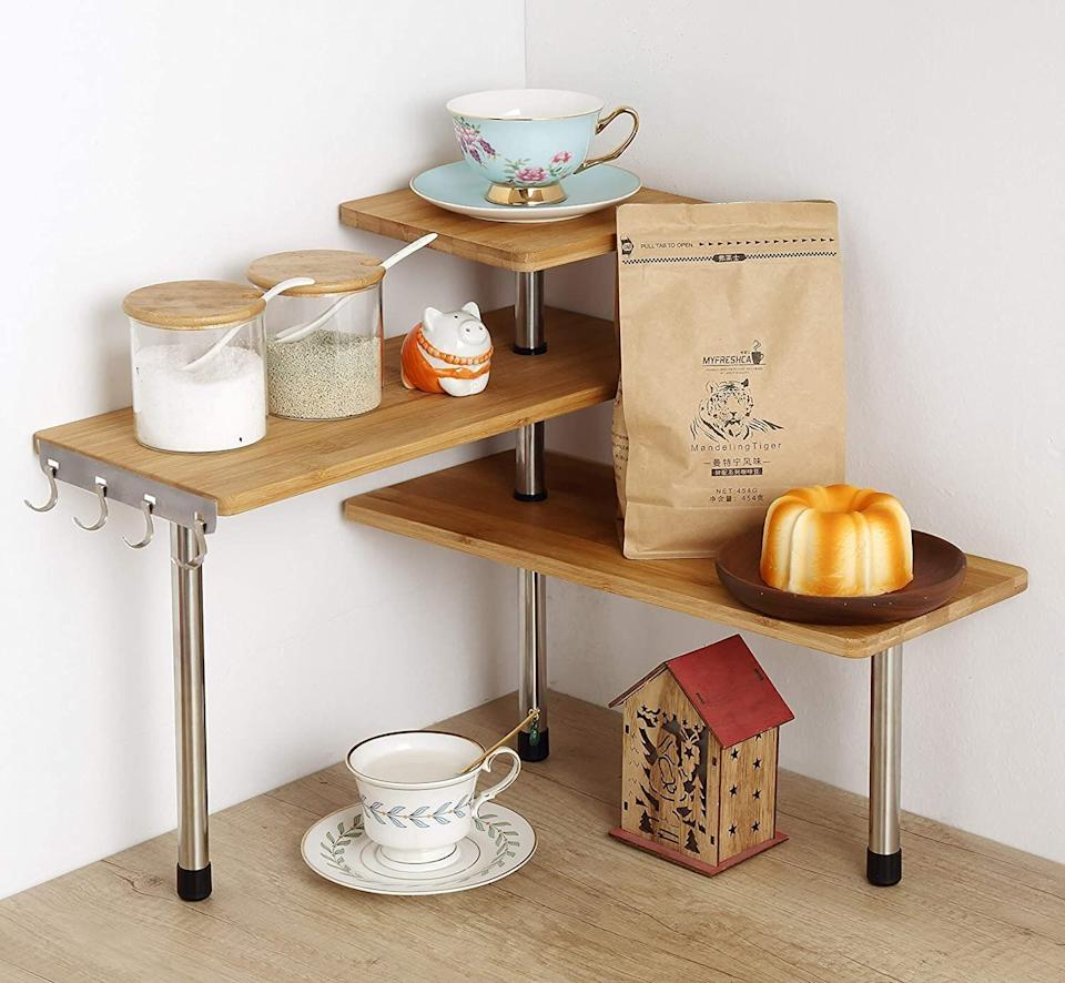 "This <a href=""https://amzn.to/3ox9tzn"" target=""_blank"" rel=""noopener noreferrer"">three-tier organizer</a> is perfect for awkward corner countertops where it's easy to underutilize the space. Use this to store mugs and plates, coffee and tea accessories or to display cookbooks. <a href=""https://amzn.to/3ox9tzn"" target=""_blank"" rel=""noopener noreferrer"">Get it for $30 on Amazon</a>."