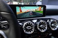 Car racing game is seen on the screen inside a Mercedes Benz vehicle at the CES Asia exhibition in Shanghai