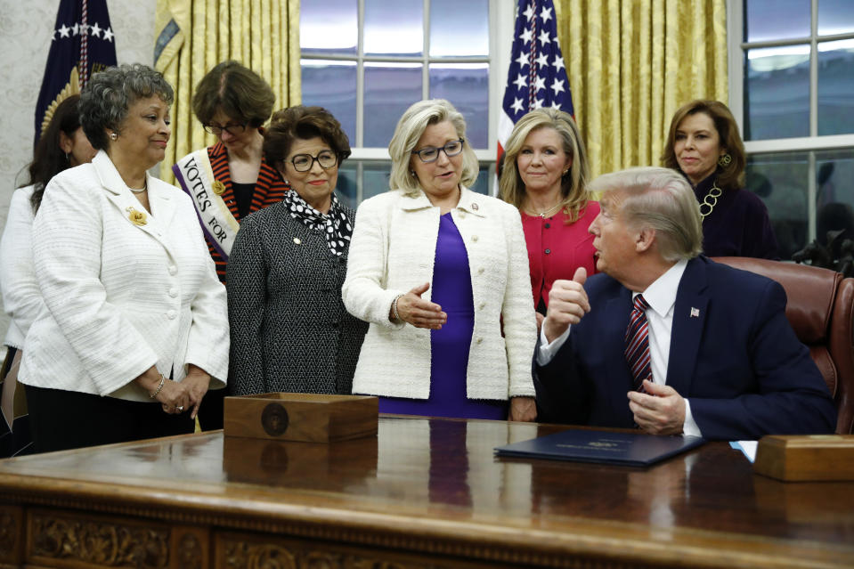 FILE - In this Nov. 25, 2019, file photo, Rep. Liz Cheney, R-Wyo., center, speaks with President Donald Trump during a bill signing ceremony for the Women's Suffrage Centennial Commemorative Coin Act in the Oval Office of the White House in Washington. Trump and his supporters are intensifying efforts to shame members of the party who are seen as disloyal to the former president and his false claims that last year's election was stolen from him.(AP Photo/Patrick Semansky, File)
